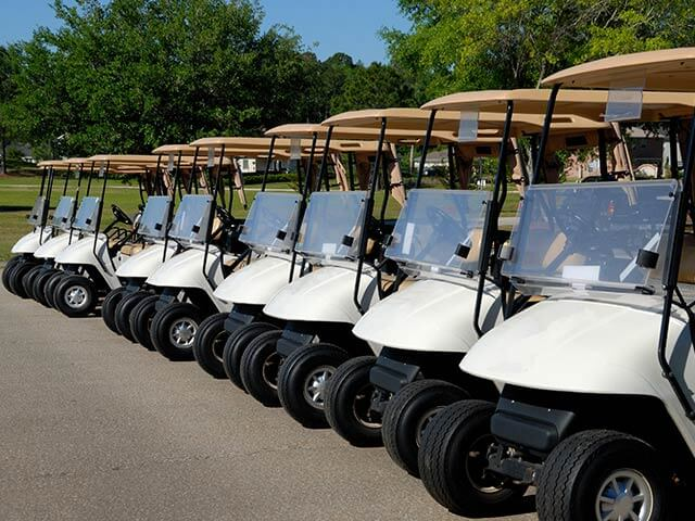A line of golf buggies
