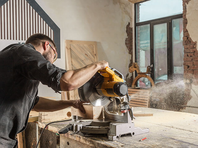 A man using a power tool